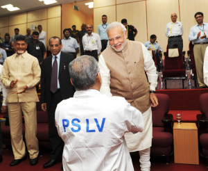 The Prime Minister, Shri Narendra Modi congratulating the ISRO Chairman, Dr. K Radhakrishnan on the successful launch of PSLV C23, at the Mission Control Centre, at Sriharikota, in Andhra Pradesh on June 30, 2014. The Chief Minister of Andhra Pradesh, Shri N. Chandrababu Naidu is also seen.
