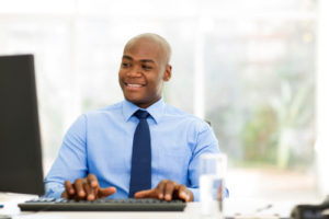 handsome african businessman looking at computer screen